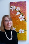 Kathy Richardson standing next to an Apricot flower blossom mosaic