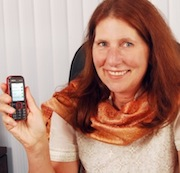 Carol Realinni with inexpensive cell phone
